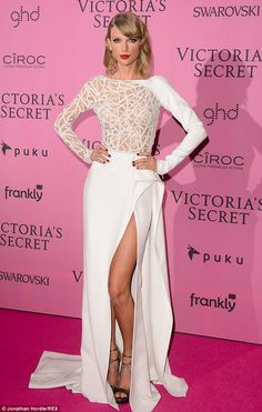 Wowing: Taylor stunned in a white gown with sheer paneling as she graced the red carpet on...