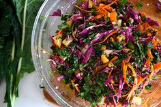 Kale Slaw with Red Cabbage & Carrots  Print This Recipe   makes 4 servings    (recipe adapted from Whole Living Foods Magazine)    1 tablespoon olive oil   1 tablespoon Dijon mustard   1 teaspoon apple-cider vinegar   Coarse salt and pepper   3 cups mixed shredded kale and red cabbage   1 carrot, peeled and julienned   1 apple, chopped   1/4 cup fresh parsley leaves   2 tablespoons diced red onion   1/4 cup chopped roasted cashews   2 tablespoons hemp seeds   lime juice   1/2 avocado (optional)   In a small bowl, whisk olive oil, mustard, and apple-cider vinegar. Season with salt and pepper.    In another bowl, combine kale, cabbage, carrot, apple, parsley, and red onion with cashews & hemp seeds.    Season with salt and pepper, drizzle with dressing, and toss to coat. Garnish with avocado.