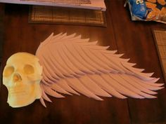 cemetery arch inspiration from hf member. use gs skull  & foam wings.