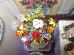 Nov. 30, 2014 - This floral display is made of paper flowers (so tiny).  I won it as a door prize at a miniature show in Westbank, B.C. three years ago (at the Miniature Enthusiasts of the Central Okanagan Show and Sale).  The detail is incredible!  I mounted it on the plastic case it came in it would sit higher up; with the case being clear it would not obstruct the design of the rear wall.