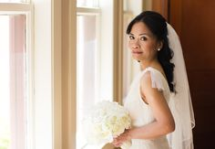 Bridal portraits before the ceremony. The bride holds a White by Vera Wang gown and carries fabric flowers  http://poppyandjune.com/2015/08/10/real-wedding-jack-pearl/