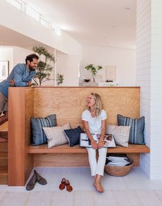 Home owners Jed and Jessica enjoy a wooden seating nook in their family room.