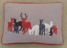 Festive Reindeer Red 28cm x 48cm cushion cover (from: £16.68) - Festive Themed Applique and Stitch Wool Cushion Cover  http://www.ukcurtainsandinteriors.co.uk/acatalog/Festive-Reindeer-Red-28cm-x-48cm-cushion-cover-19788.html