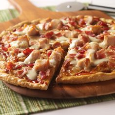 Chicken pizza recipe starts with a pizza kit and adds cheese, chicken, bacon and a drizzle of ranch dressing.