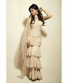 Mouni Roy in a ruffle salwar kameez Sharara Designs, Lehenga Designs, Kurti Designs Party Wear, Designer Bridal Lehenga, Indian Gowns, Indian Attire, Indian Wear, Pakistani Dress Design, Pakistani Outfits