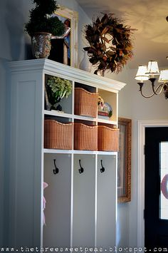 Wow! Incredible!! We HAVE to make this for our back entrance!! Here are more details on how to make it...(the 2 are not identical, but it gives an idea of how to go about making it...)  http://www.acharmingnest.com/2011/07/mudroom-storage-reveal.html