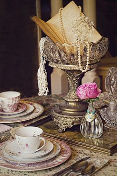 This is too busy for me but I like the idea of porcelain with an antique book and florals