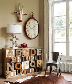 I wonder if I can get the toy shelves too look like this.  Would a large wooden letter on each bin of toys look this amazing?