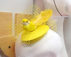A gorgeous little bird hat by Imogen's Imagination who offers handmade vintage and burlesque inspired hats, headbands and hair accessories. They can be found on Etsy and in Bird's Yard, Sheffield.