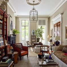 small living room layout, tall windows, stained doors with painted casing Greenwich Village, Architectural Digest, Brooklyn Brownstone, Home Design, Interior Design, Interior Door, Urban Design, Modern Interior, Antique Dining Tables