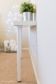 Simple IKEA Hack: Narrow console table using Lack shelf and any two Ikea legs. Install the shelf on the wall according to directions on package. Just make sure the height allows the legs to reach the ground. Hall Table Ikea, Table Console Ikea, Narrow Console Table, Ikea Wall Table, Wall Mounted Table, Ikea Lack Shelves, Lack Shelf, Floating Shelves, Ikea Hacks