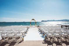 Wedding Arch for Destination Romantic Beach Wedding in Cannes, French Riviera. The arch was dressed with gold fabric and a variety of seasonal flowers.
