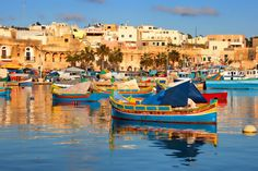 Malta - Marsaxlokk harbour is a must see and the market is a fun place!