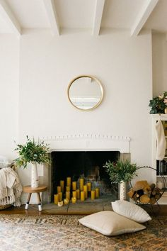 Arrange a cluster of candles under your mantel or near your fireplace for added heat.