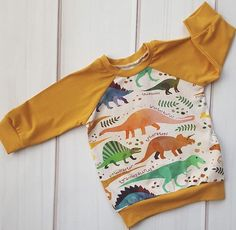 The cutest dinosaur sweater for your boys! Toddler Fashion, Toddler Outfits, Baby Boy Outfits, Boy Fashion, Fall Outfits, Kids Outfits, Dinosaur Sweater, Handmade Baby Items, Cool Kids Clothes