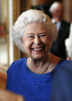 Queen Elizabeth II greets guests at a reception for winners of The Queen's Awards for Enterprise 2014 at Buckingham Palace on July 14, 2014 in London, England.