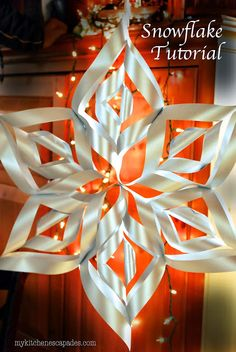 Large Paper Snowflake Tutorial - My Kitchen Escapades -these make huge, gorgeous snowflakes that are 2 feet across! Christmas decoration ideas