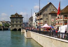 Along the Limmatquai, a popular riverside shopping street - Zurich Switzerland Travel Guide, Switzerland Tourism, Town Hall, Cheap Places To Travel, Shopping Street, Easy Day, Cheap Hotels