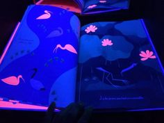 Books to explore under black light - We usually use our DIY Black Light Booth for art and light play, but lately it's been a great provocation to explore books!