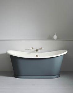 Bateau Bath with wall mounted taps on false wall forming a shelf behind bath