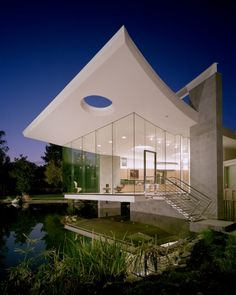 The light in this photo draws attention to the cool modern house while still looking beautiful around it.