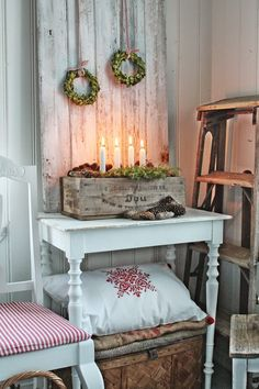 Rustic board with wreath on it, I'd use one large wreath instead
