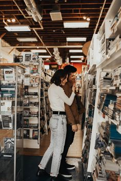 Los Angeles engagement shoot in DVD and record player store. Hana Alsoudi Photography