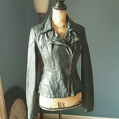 Free people VEGAN Leather Moto Jacket Size 4 Free people VEGAN Leather Moto Jacket. Size 4. Color: Dark Hunter Green. In flawless condition! Absolutely no defects of any kind. Fully lined. Supple soft leather feel. Asymmetrical front zipper closure with unique button down flaps for versatile Style. Two front zipper Pockets. Zipper in each wrist. 100% polyurethane. Machine wash cold, line dry. Feel free to ask any questions. MAKE ME AN OFFER! FREE GIFT with every purchase! Bundle for further…
