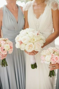 Perfect bridesmaids.  Pale/powder blue dress with soft pink and white flowers.