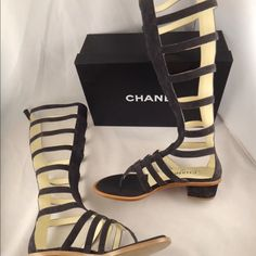 Nwt Chanel gladiator boots NIB Chanel 15S Grey Suede Leather Strappy Zipper Gladiator Knee Sandals 37 $1750   ********** Chanel **********   Brand: Chanel Size: 37 (know your  size)  Name: 15S Color: Dark Grey Style: Lace Up Gladiator Sandal Style#: G30810X05897 Material: Suede Calfskin Leather Retail: $1750+tax Open front toe Block heel gladiator sandal Dark grey suede Back full length zipper CC zipper pull Strappy design throughout CHANEL Shoes Ankle Boots & Booties
