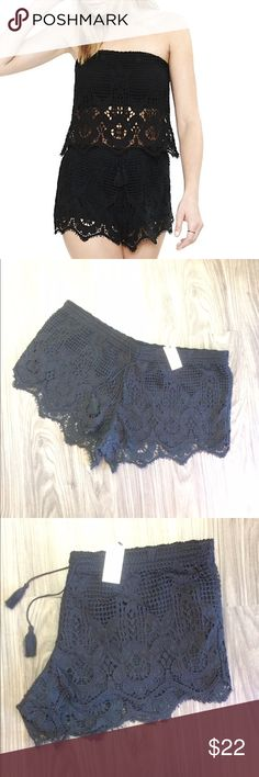 """Express Black Crochet shorts BNWT Adorned with delicate crochet lace that extend just past the T-shirt soft jersey lining, these short shorts represent a winning mix of seductive styling and crave-worthy comfort.  2.5"""" inseam Banded drawstring waist, slip-on styling Jersey shorts with crochet overlay Scalloped hem Cotton/Modal Hand wash separately Imported Express Shorts"""
