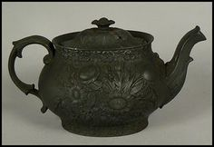 Early 19th Century Black Basalt Pottery Teapot, beautifully decorated with a Floral design in low relief