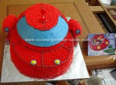 Little Einsteins Rocket Cake: My son is really into The Little Einsteins, so for his birthday my wife decided to have that as the theme. She bought all the party favors then looked