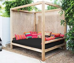 Perfect Daybed... I want to curl up here with a coffee and a good book and read the day away!