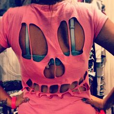 DIY cut-out skull shirt. Want to do this on the front of a white shirt & then wear a black tank underneath for a simple, comfy Halloween