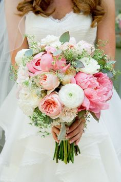 Gorgeous wedding bouquet with Peony, Garden Roses, Ranunculus in white, pink, peach and greens.