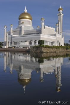 The Omar Ali Saifuddien Mosque reflecting the moat, accentuating the glittering dome, covered in real gold - Brunei