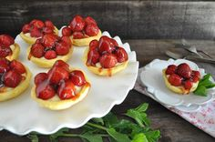 Mini Strawberry Tarts with Orange Crust filled with pastry cream tart shells baked on upside down muffin pan