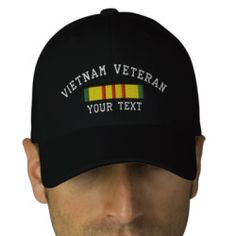 Vietnam Veteran Baseball Cap - US Military Vietnam Service ribbon with Vietnam Veteran above and text below. Both lines of text can be changed. Thread outside of ribbon can be changed to match hat color.