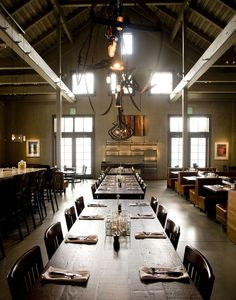 Farmstead restaurant by EDG Interior Architecture long table with roof.  Love the modern Farm to Table!