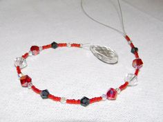 Red Swarovski Crystal Beaded Suncatcher by PandorasCreations, $18.00 glass beads: http://www.ecrafty.com/c-2-glass-beads.aspx