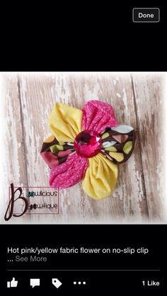 Pink, yellow, and brown fabric flower