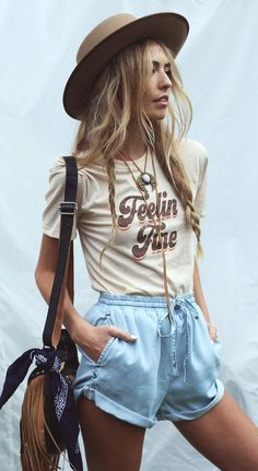 hippie girl summer outfit|Top|Tee|Nude|Cream|Off white|Short sleeve|Printed|Graphic|Tucked in|Shorts|Short|Blue|Sky|Light|Leg|Arm|Purse|Shoulder bag|Brown|Necklace|Drawstring|Yarn|Gold|Rusty|Rusted|Accent|Nail|White|Hat|Sun|Silver|Summer|Spring|P345