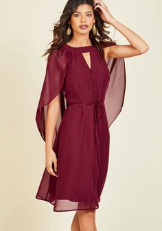 The neckline cutout and delicate buttons of this burgundy dress from our ModCloth namesake label make this look a delight, but those are only the beginning. This vintage-inspired frock's gorgeous cape - which can be worn draped over the shoulders or tossed behind them - is the signature detail, creating a sweet sophistication meant for indulgence.