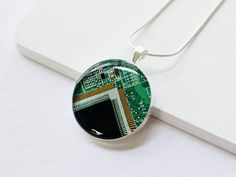Intricate geek chic jewelry is made from recycled electronic circuit boards