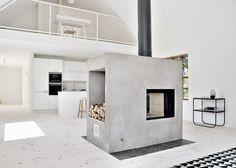Lofty Swedish house with a concrete fireplace by Sandell Sandberg. Love the fireplace