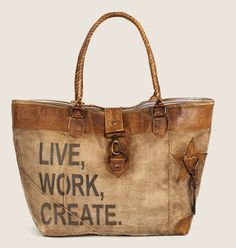 Our large artistic inspired grunge leather and canvas tote is a must have! Live, Work Create printed on the front. Features drop handles, trim, tabs, decorative patches and clasp in soft leather on a stone washed canvas body. it has an inside pocket with a stylish ticking lining. Measures: ...
