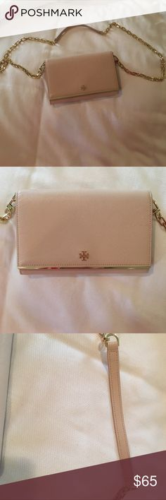 Tory Burch pink clutch gold chain removable strap Only worn 5 times to special events, inside is super clean and looks brand new, chain is in great condition, purse is not worn looking at all but unfortunately, has pink stains on the bottom and back of it (no idea what they are from), fits tons of credit cards and ids and has a zipper pouch for important things, I am selling because I cannot fit my brush comfortably in this purse Tory Burch Bags Clutches & Wristlets