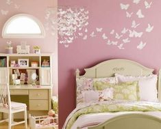 love the butterfly light fixture with the butterfly motif on the wall, perfect for the girls room