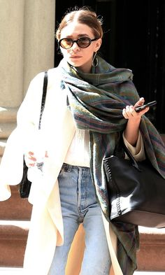 Ashley heads out in NYC in a 90s-inspired layered look with a plaid scarf and light-wash jeans.